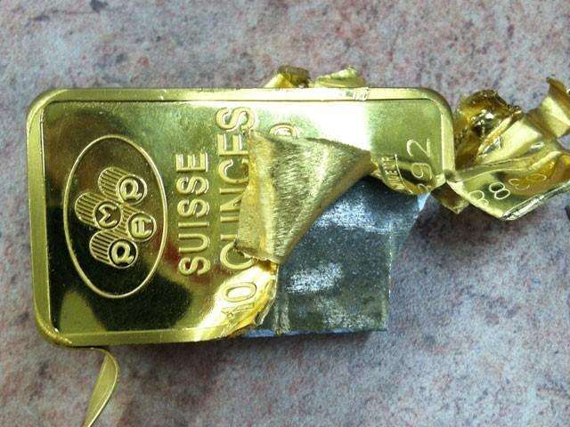Barras de ouro falsas